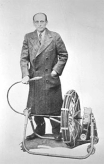 Samuel Oscar Blanc (1883-1964) with an early Roto-Rooter sewer cleaning machine.